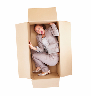 Frustrated business woman stuck in a box isolated
